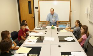 Conrad Storad teaching the Young People's Writing Workshop (Photo by DJ Craig)