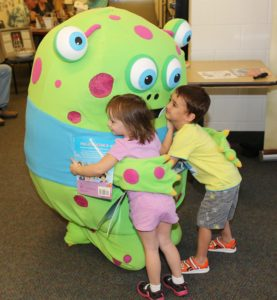 Kids hugging Story Monster! (Photo by DJ Craig)